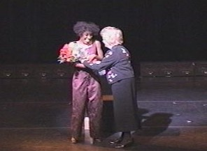 Receiving flowers from Mrs. Judge, Executive Director of NAMI-Tennessee, after the performance of Balancing Act at the Ryman in Nashville.