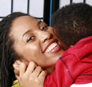 Woman and baby hugging